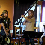 LaRaine introducing Amanda Marino, before an appreciative crowd, at the BC Songwriters' - Songwriter Showcase - in Langley, BC