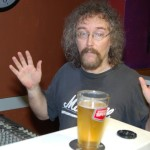 Bob the Sound Guy, proclaiming his innocence over a 'sipped' beer, at the BC Songwriters' Showcase & Open Mic, in Langley