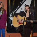 Talia Dyke, accompanied by sister Vienna, performing at the BC Songwriters' Open Mic