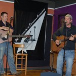 Trent Olver and Glen Mager, swapping songs back and forth at the BC Songwriters' Showcase, in Langley - BCSongwriters.ca