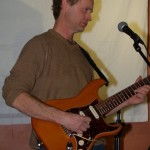Dave Mercer - accompanying Open Mic performers, on his new guitar - BCSongwriters.ca