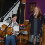 John Haynes being introduced by LaRaine, at the start of the BC Songwriters' Showcase - BCSongwriters.ca