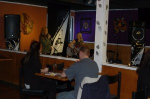 LaRaine introducing Lisa Nicole, before an appreciative crowd, at the BC Songwriters' - Songwriter Showcase - in Langley, BC