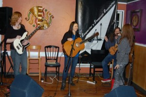 LaRaine introducing Lotus Band, as they perform at the BC Songwriters Showcase Association's Songwriter Showcase, in Langley