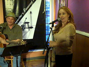 LaRaine introducing Earl Travis Taylor, at the BC Songwriters' Open Mic, at NY Grill & Bistro, in Langley