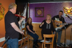 LaRaine (second from left) taking it easy, as The Flying Ritas finish their sound check, before performing at the BC Songwriters' Showcase