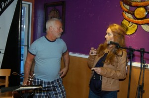 LaRaine talking to Bruce Rudolph, at the BC Songwriters' Open Mic