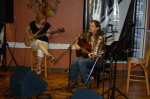 John Haynes (accompanied by Terri Breeze, left) played a couple of his Texas toe-tappers, at the BC Songwriters' Open Mic — at BC Songwriters' Showcase Association.