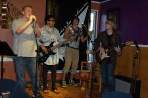 Mundania band, playing the BC Songwriters' Open Mic. Band members are (left to right) Chris Ramsden, Feven Banyard, Mike Svetlikov, Harrison Breeze