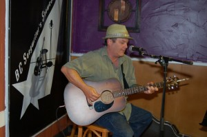 Earl Travis Taylor performing at the BC Songwriters' Open Mic, in Langley
