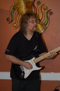 Bob Batyi playing guitar at the Songwriter Showcase